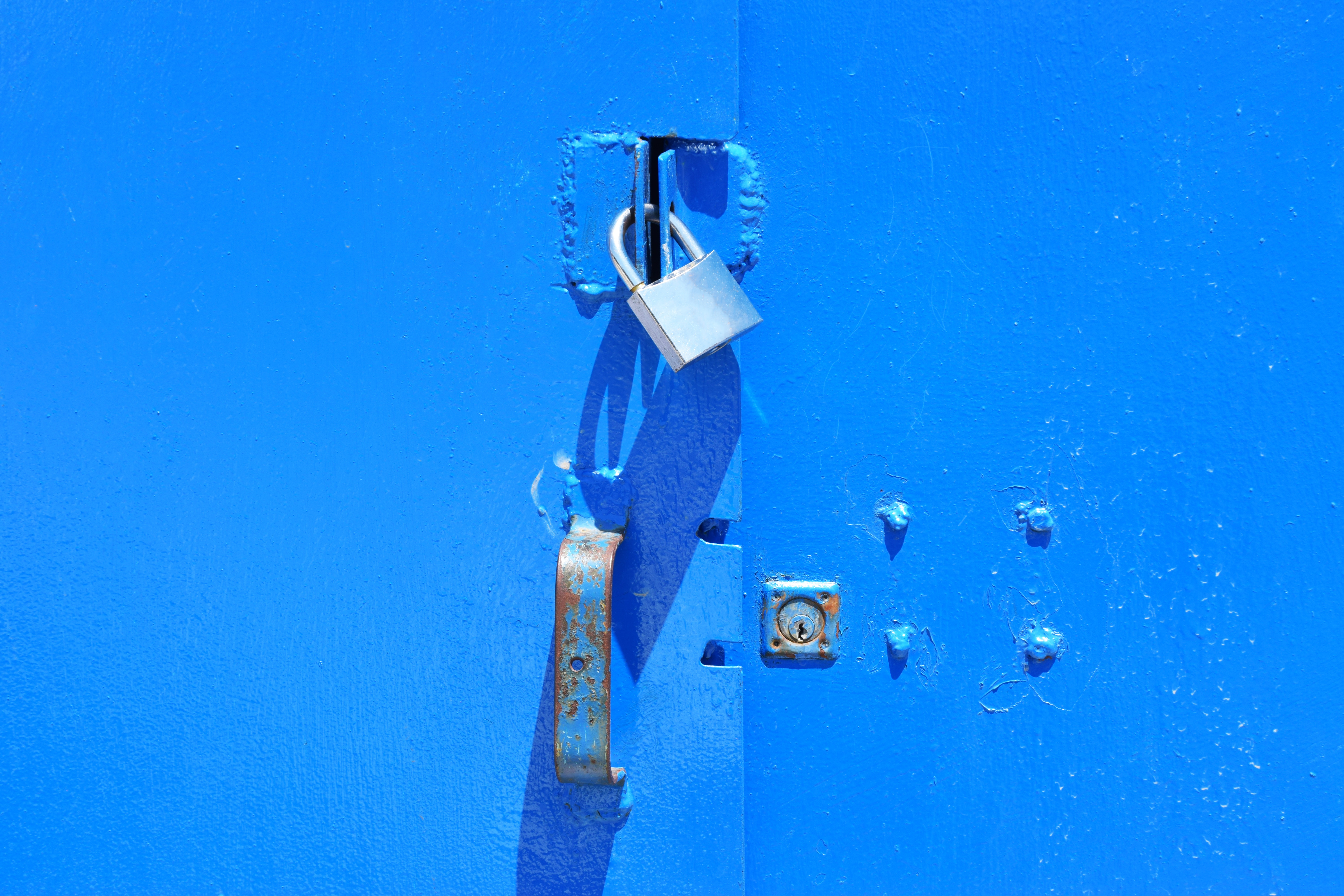 A lock securing a blue window as Screenly secures your digital signage.