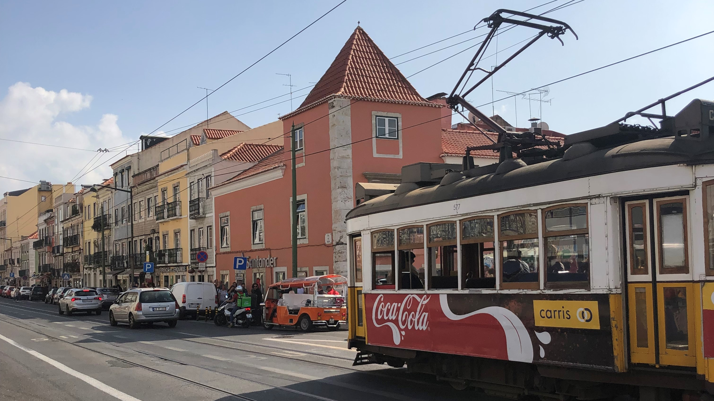 The street near the Pastéis de Belém bakery and a Lisbon cable car.