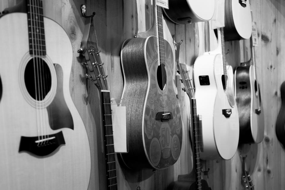 This is an image from StockSnap of guitars on a wall that is great for use with digital signage networks.